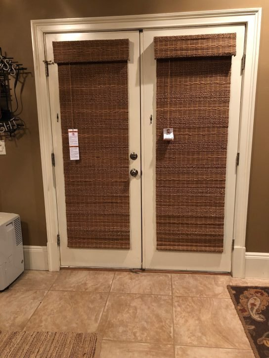 Hunter Douglas bamboo woven wood Roman shades on a door atlanta